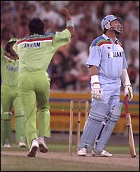 Wasim Akram celebrates the wicket of Ian Botham in the 1992 World Cup in Melbourne