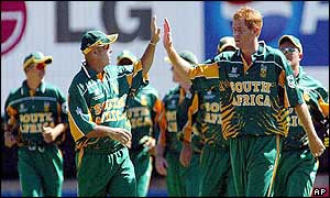 South Africa's captain Shaun Pollock celebrates with teammate Herschelle Gibbs