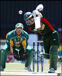 Bangladesh batsman Khaled Mahmud blocks the ball in front of South African wicket keeper Mark Boucher