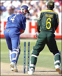 Alec Stewart is bowled by Shahid Afridi