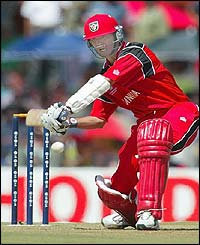 Canada's John Davidson carves the ball towards the boundary