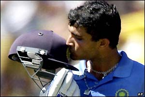 Ganguly kisses the Indian badge on his helmet after his century