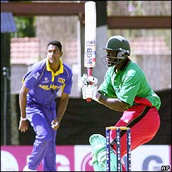 Kenyan batsman Kennedy Otieno hooks the ball to the boundary
