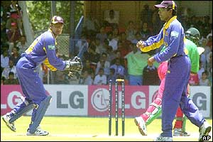 Kenya batsman Tony Suji is clean bowled by Sri Lanka's Muttiah Muralitharan