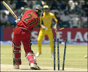 Glenn McGrath removes Brian Murphy with a superb yorker with Zimbabwe