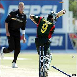 Bangladesh's Sanwar Hossain is clean bowled by New Zealand's Jacob Oram