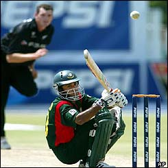 Bangladesh batsman Khaled Mashud ducks to avoid a fast ball from New Zealand's fast bowler Kyle Mills
