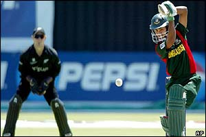 Bangladesh's Mohammad Ashraful plays a shot as New Zealand's Brendon McCullum
