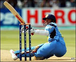 Sachin Tendulkar watches from the floor as the ball travels to the boundary rope