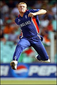 England's Andrew Flintoff leaps into the air as he celebrates the wicket of India's Sachin Tendulkar
