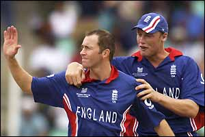 England's Craig White and Andrew Flintoff celebrate the wicket of India's captain Sourav Ganguly