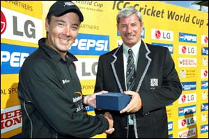Craid McMillan receives the man-of-the-match award from Sir Richard Hadlee