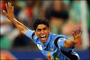 India's Ashish Nehra celebrates capturing Alec Stewart's wicket,