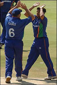 Burton van Rooi of Namibia celebrates taking the wicket of Australia's Adam Gilchrist