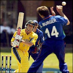 Australia's Matthew Hayden drives the ball past Namibia's Louis Burger