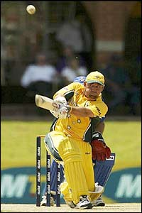 Australia's Darren Lehmann hits a six on his way to scoring 28 runs from the final over