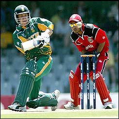 South African batsman Boeta Dippenaar hooks the ball while Canadian wicketkeeper Ashish Bagai looks on