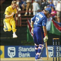 Australia's Andy Bichel celebrates the wicket of Rudi Van Vuuren