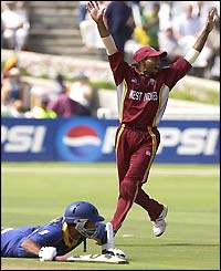 Marvan Attapattu is caught short of his ground as Shivnarine Chanderpaul appeals for the run out