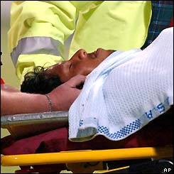 Ramnaresh Sarwan is laid on a stretcher after being hit by a bouncer