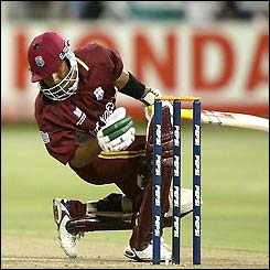 Ramnaresh Sarwan is hit on the head by a bouncer