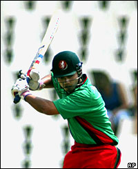 Kenyan batsman Brijal Patel shapes to play a shot