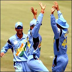 Indian players celebrate the run out of Inzamam-ul-Haq