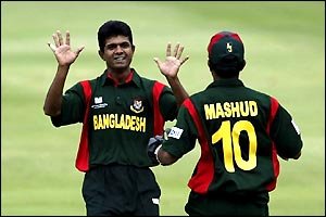 Sanwar Hossain of Bangladesh celebrates taking the wicket of Steve Tikolo