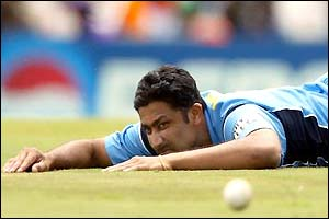 Anil Kumble can only watch as the ball flashes past his dive to the boundary