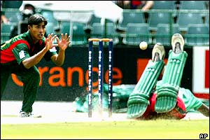 Bangladesh fielder Mohammad Ashraful attempts the run-out of Kenyan batsman Collins Obuya