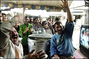 Pakistani fans at a tea stall celebrate Saeed Anwar's 100