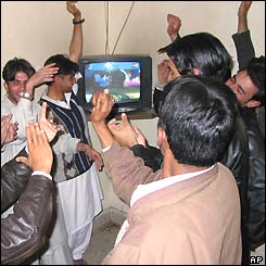 Fans in Rawalpindi gather round a TV set