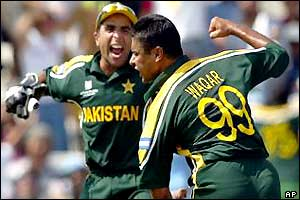 Taufeeq Umar celebrates the dismissal of Sourav Ganguly with wicket-taker Waqar Younis