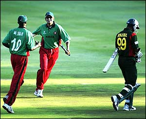 Ravindu Shah of Kenya celebrates victory after Kenya claim the final wicket of Monjural Islam