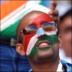 A face-painted Indian fan looks on at events unfolding at Centurion Park