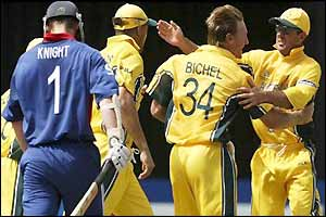 Andy Bichel celebrates with his team-mates as Nick Knight  walks off