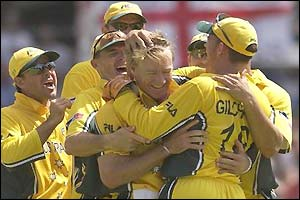 The Australian's congratulate Andy Bichel who records the second-best bowling figures in World Cups