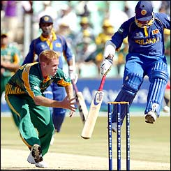 Sri Lankan batsman Sanath Jayasuriya jumps to avoid being hit as South Africa's Shaun Pollock attempts a run-out