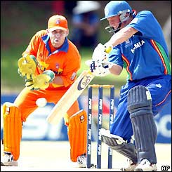 Holland's wicket-keeper Jeroen Smits cannot prevent Namibia's JB Burger from making 41 runs before being caught by substitute Nijman