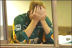 South AFrica captain Shaun Pollock hides his face as the emotion sets in as he learns his side will not go through to the Super Six stage