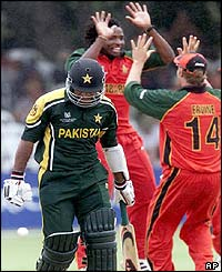 Pakistan batsman Saleem Elahi leaves the field after being dismissed by Zimbabwe's Douglas Hondo