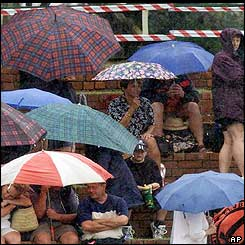 Fans shelter under umbrellas as heavy rain returns to Bulawayo