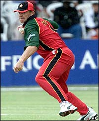 Zimbabwe's Heath Streak fields the ball as play resumes after a rain break