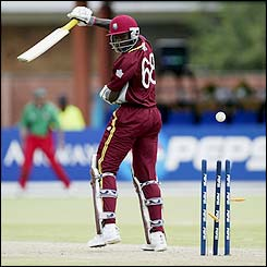 West Indies' Wavell Hinds is bowled by Kenya's Martin Suji