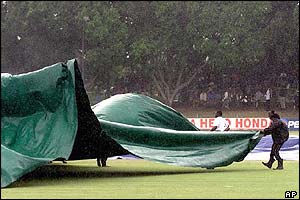 The covers return to the outfield as the rain returns to Bulawayo