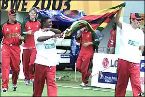 Zimbabwe's players wave a flag and do a lap of honour in Bulawayo to celebrate reaching the Super Sixes