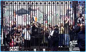 Pupils block 10 Downing Street gates in an anti-war march
