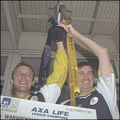 Donald and Tim Munton with the Sunday League trophy that Warwickshire won in 1997