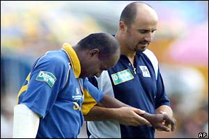 Sanath Jayasuriya is helped from the field after his injury