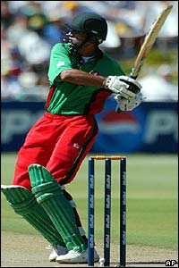 Kenya's Ravindu Shah hits the ball towards the boundary against India